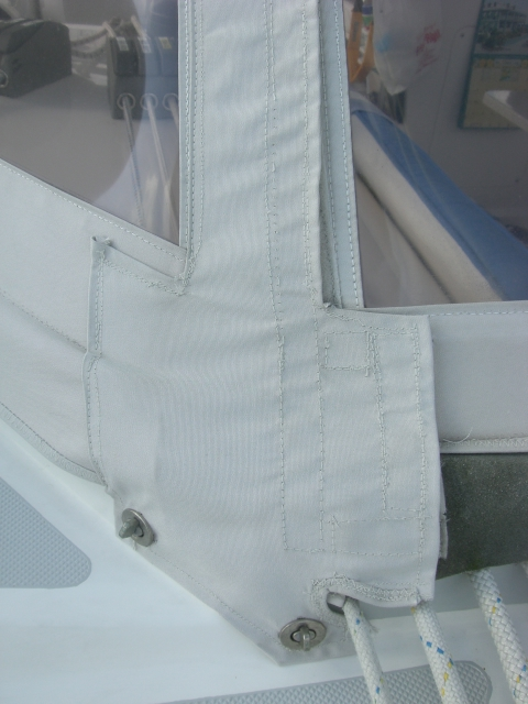 Sunbrella flaps covering zippers.