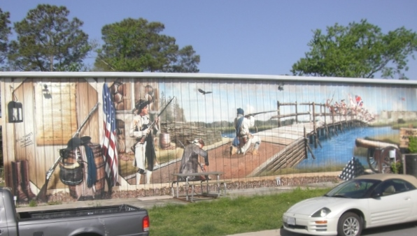 Local sign shop displays mural of Battle at Great Bridge.