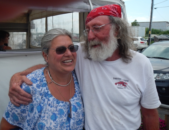 Kerry schmoozes with the owner of Lobster Landing.