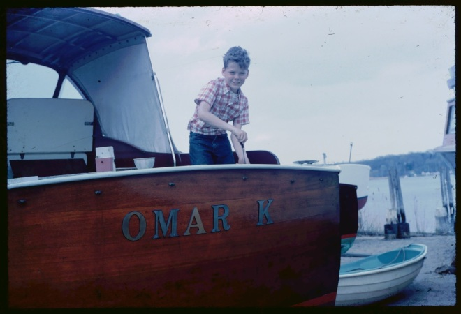 A very young Russ working on the stern of the Elco