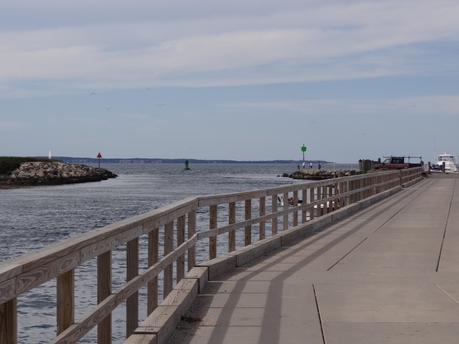 Looking down the long dock toward the harbor entrance