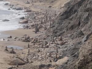 Cairns piled across the beach