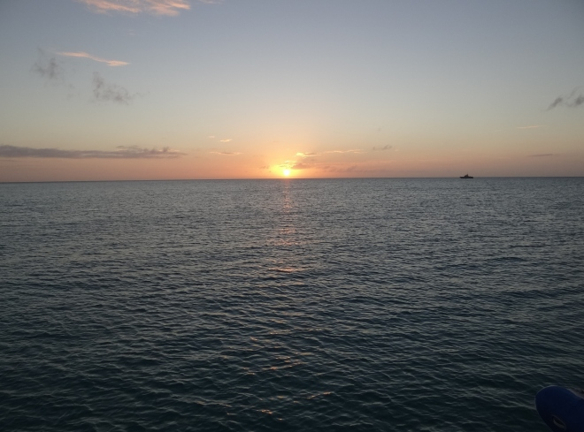 Black Point Sunset - Bahamas Defense vessel stands watch