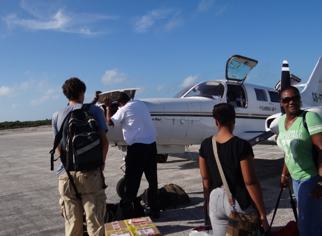 Benj, the multi-talented pilot, Ida and her daughter wait to board (Jan 2013)