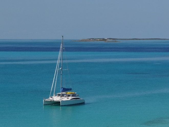 Ortolan at anchor with Staniel Cay in the distance