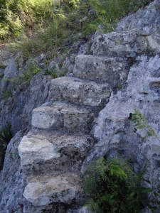 Steps cut into the rock help you climb up. They may also be Stations 5 and 6
