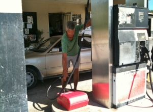 Pay the attendant, who pumps vehicles but not gas jugs. Just like years ago.
