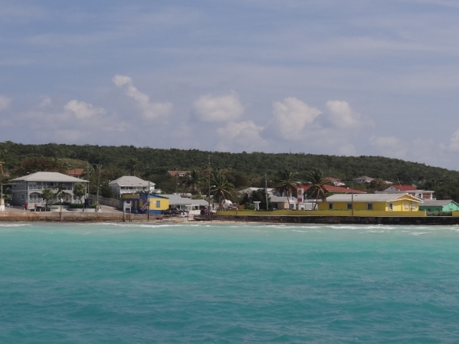 View from our stern of the beach and harbor-side buildings at low tide