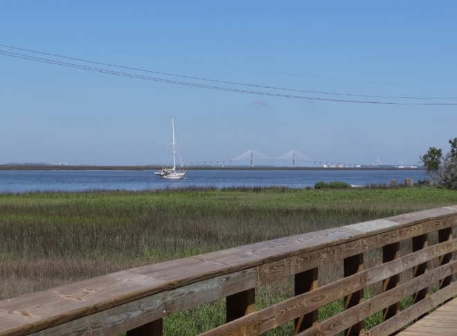 A sailboat heads up Jekyll Creek-probably at mid tide or better
