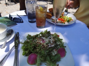 A delicious salad of greens, watermelon radish slices, walnuts and more.