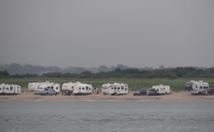 A long line of trailers lined the beach
