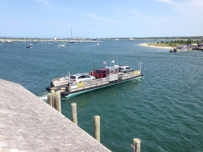 The always on time ferry crosses over to Chappaquiddick by the entrance into the harbor