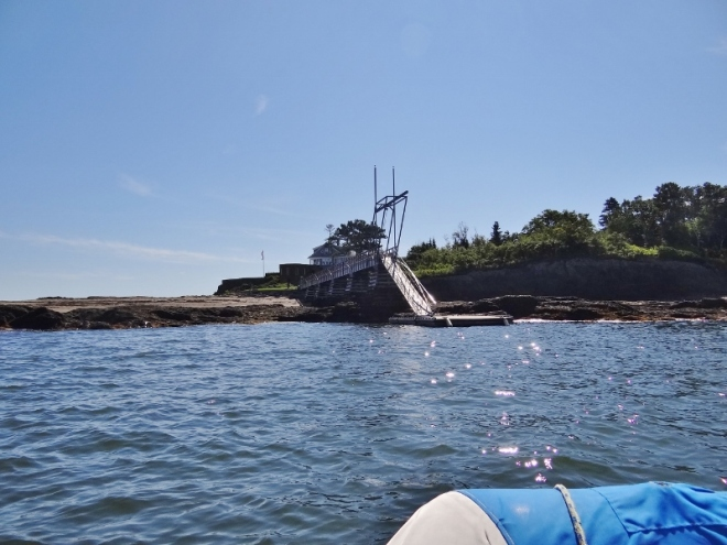 We approach the dinghy dock. Boy that's a steep ramp up, thanks to nearly low tide