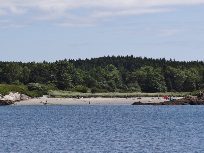 One of 5 or 6 sandy beaches nestled within the rocky shore