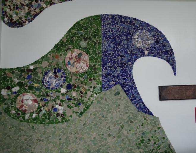 Glass and pottery mosaic- so that's where all the sea glass is