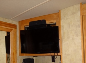 New flat screen TV  with blu-ray DVD player and mini sound bar.