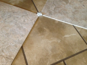 The old tile had faux grout and hid dirt really well