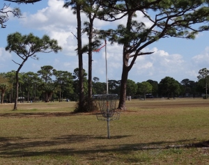 A disc golf basket/hole- the game is played by tossing a small Frisbee-like disc