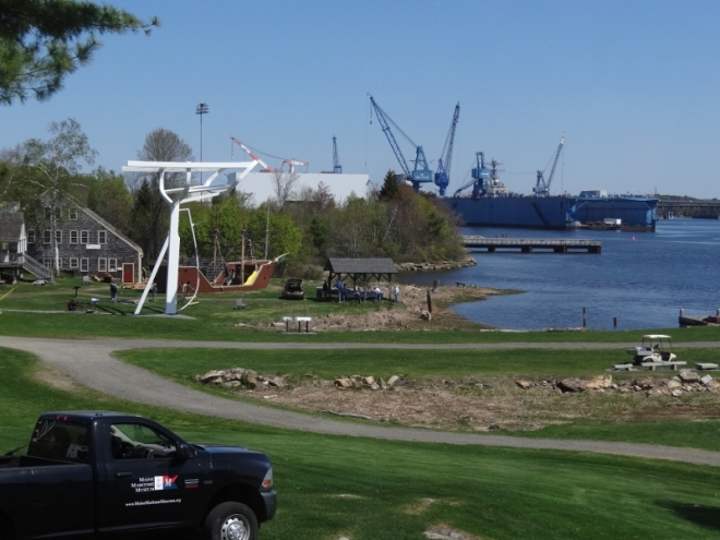 The huge dry dock at Bath Ironworks is visible in the background