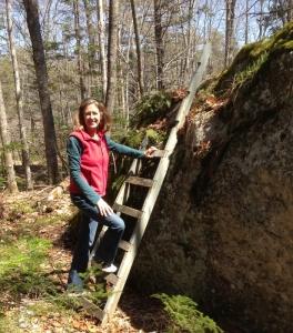 I begin the ascent up the erratic glacial boulder.