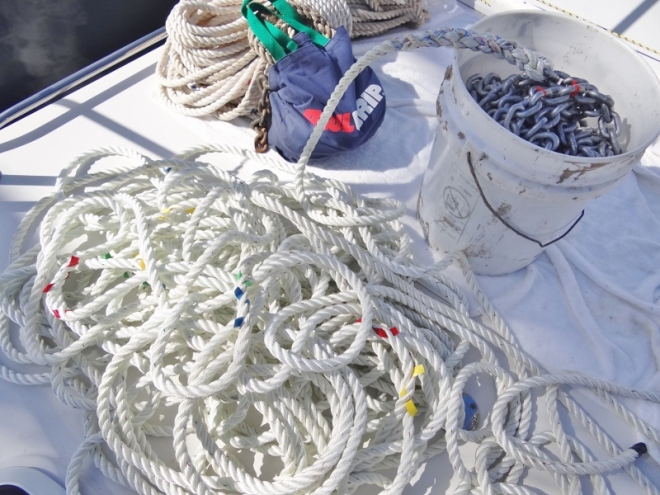 Line marked with tape and chain in bucket, old chain and line in background