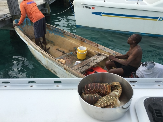 Locals stop by to sell lobster tails and conch