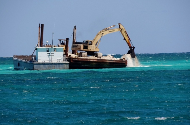 Collecting sand from sand bank near Johhny's Cay (off HT)- another reason the sand shifts
