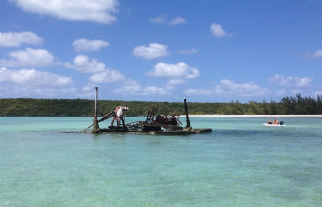 rusting equipment barge creates interest in the shallow waters at Powell Cay