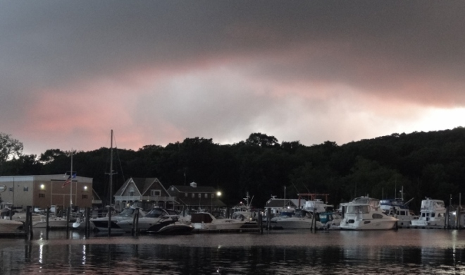 Dark storm clouds loom at sunset