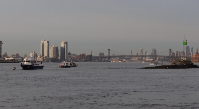 On the Roosevelt Island side, more enforcement vessels wait to enforce the 9am west channel closure