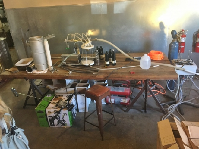The very basic low tech bottling table- 4 peeps gets the job done